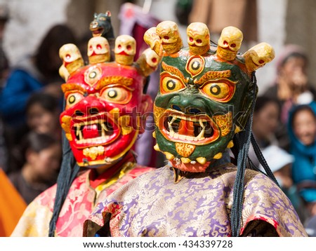 Lamayuru, India - June 17: unidentified monks perform a religious masked and costumed mystery dance of Tibetan Buddhism during the Cham Dance Festival on June 17, 2012 in Lamayuru monastery, India. - stock photo