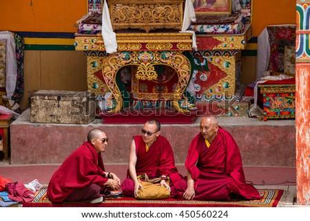 LAMAYURU, INDIA - JUNE 13, 2015: Unidentified three buddhist monk during mystical mask dancing Tsam mystery dance in time of Yuru Kabgyat Buddhist festival at Lamayuru Gompa, Ladakh, North India - stock photo