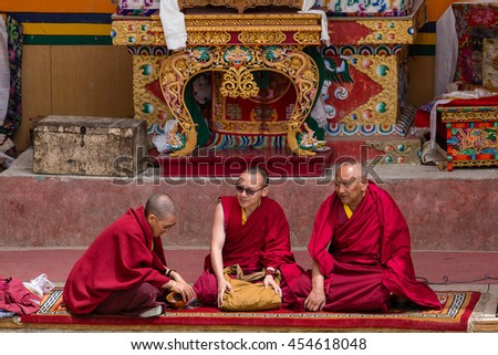 LAMAYURU, INDIA - JUNE 13, 2015: Unidentified three buddhist monk during mystical mask dancing Tsam mystery dance in time of Yuru Kabgyat Buddhist festival at Lamayuru Gompa, Ladakh, North India - stock photo