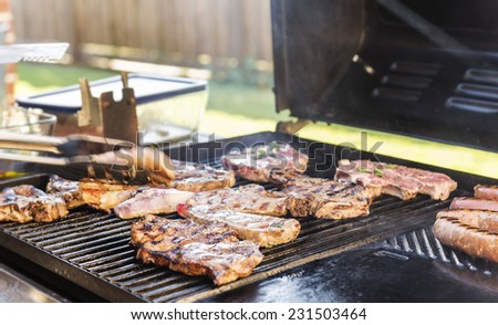 Lamb being grilled on the BBQ at an Australian barbeque outdoor dinner - stock photo