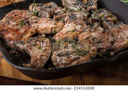 lamb chops in frying pan - stock photo