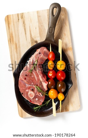 Lamb chops with cherry tomato and rosemary herb ready to cook. Selective focus. - stock photo