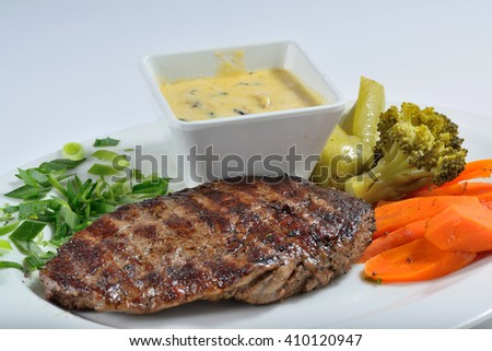 Lamb chunk roasted on white plate with sauce