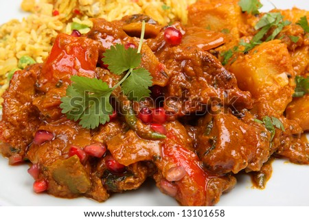 Lamb Jalfrezi with pilau rice and vegetable curry