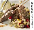 Lamb kebab and quinoa with vegetables (corn, bell pepper) - stock photo