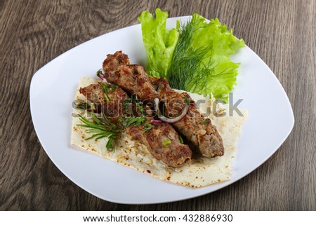 Lamb kebab with onion and rosemary