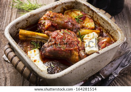 lamb knuckles with feta and eggplant - stock photo