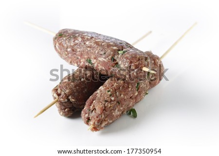 Lamb kofta skewers over a white background - stock photo