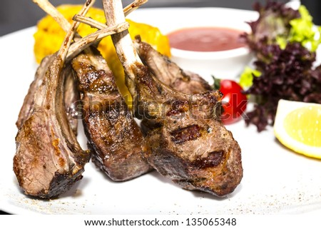lamb ribs cooked on the grill - stock photo