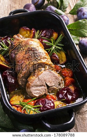 lamb roast with plums - stock photo