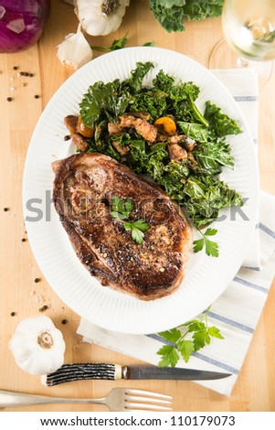 Lamb Steak Served with Wilted Kale and Vegetables