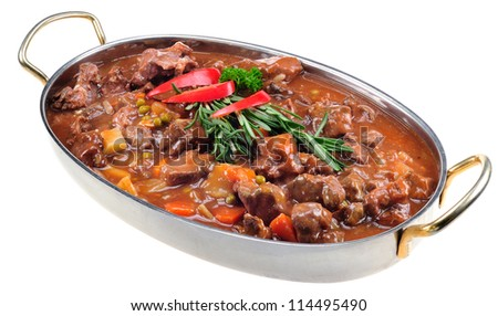 Lamb stew garnished with fresh rosemary in oval stainless dish. Isolated on white.