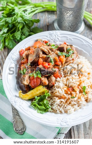 lamb stew with eggplant, vegetables and rice