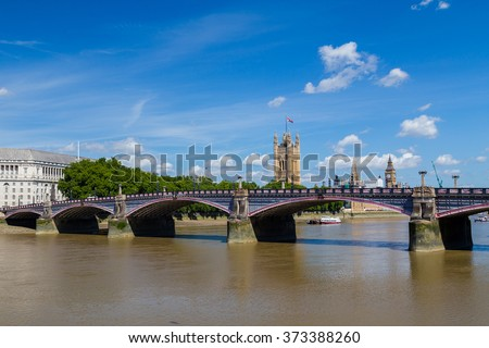 Lambeth Bridge in London during the summer. The River Thames and Westminster can be seen. There is space for text. - stock photo