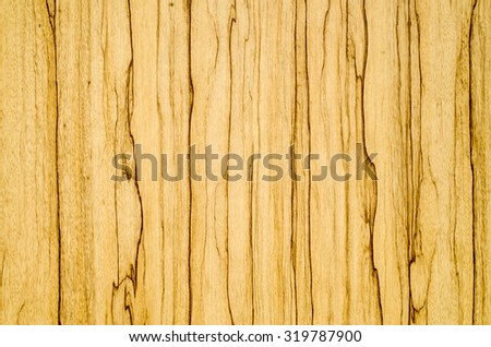 Laminated parquet board closeup in yellow and brown