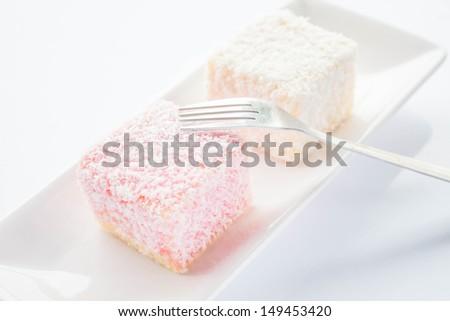 Lamington sponge cakes and fork, stock photo - stock photo