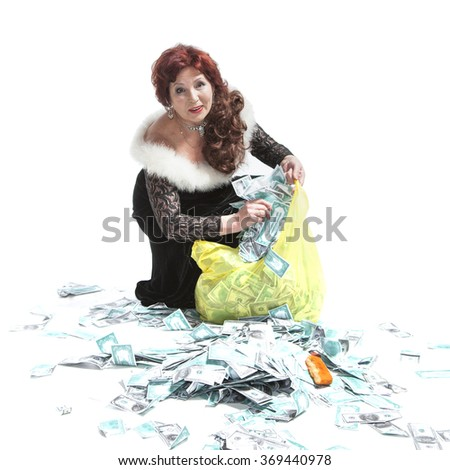 lamorous woman with a bag of money on a white background - stock photo