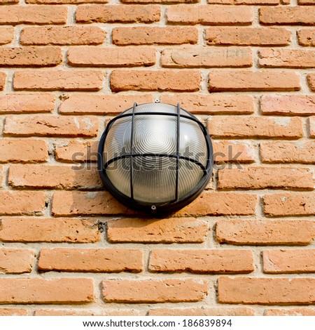 Lamp and brick wall - stock photo