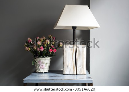 Lamp and flowers on a table - stock photo