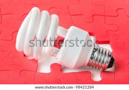 Lamp and red puzzle - concept creativity background - stock photo