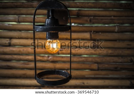 Lamp attached to a wooden cover.