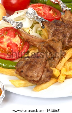 Lamp chops with french fries and salads - stock photo