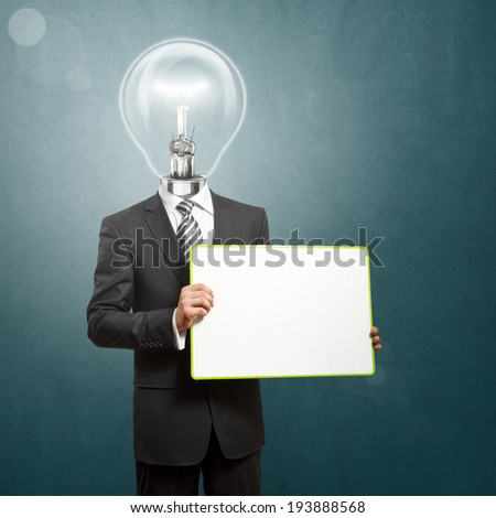 Lamp Head business man holding empty write board in his hands - stock photo