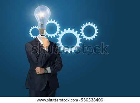 Lamp head businessman and gear.Concept of creating a working mechanism for business .