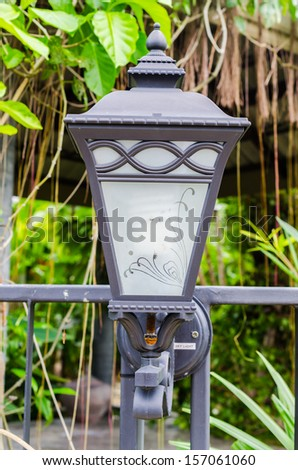 Lamp in the garden on the wall