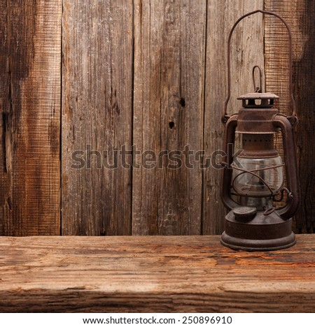 lamp oil lantern retro barn wooden background - stock photo