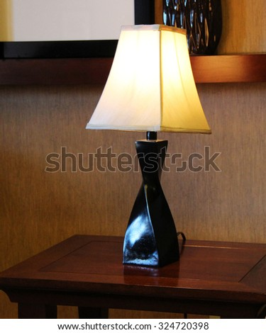 Lamp on a table - stock photo