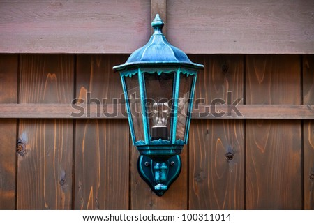 Lamp on a Wood Fence - stock photo