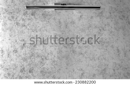 Lamp on beige wall background (black white) - stock photo