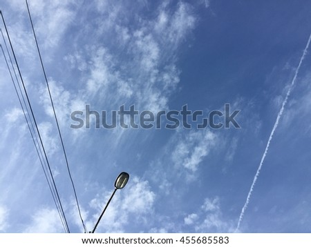 Lamp on electric pole and blue sky