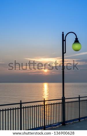 Lamp on Miedzyzdroje pier, Poland, Baltic sea - stock photo