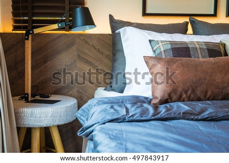 lamp on the table and pillow decorative on bed