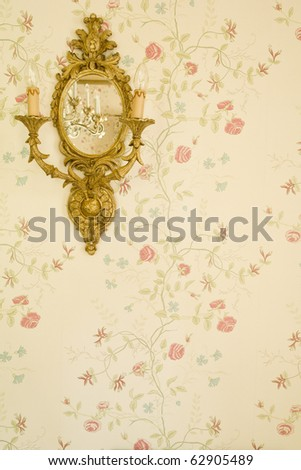 Lamp on the wall and mirror - stock photo