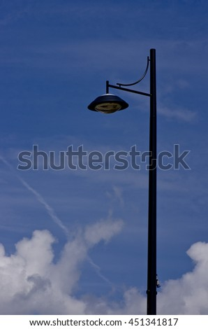 Lamp post on blue sky.