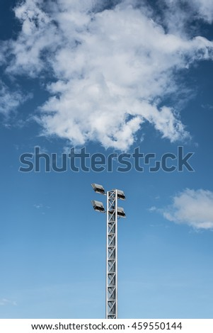Lamp post sport light with blue sky - stock photo