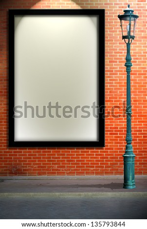 Lamp post street and blank billboard on brick wall - stock photo