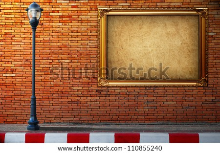 Lamp post street and frame on brick wall background - stock photo