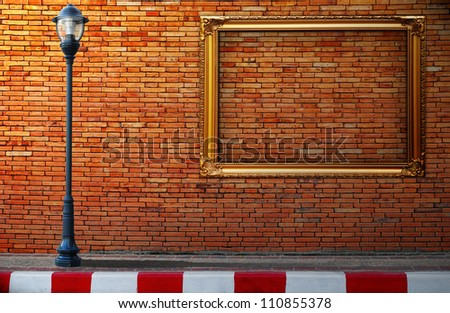 Lamp post street and frameon brick wall background - stock photo