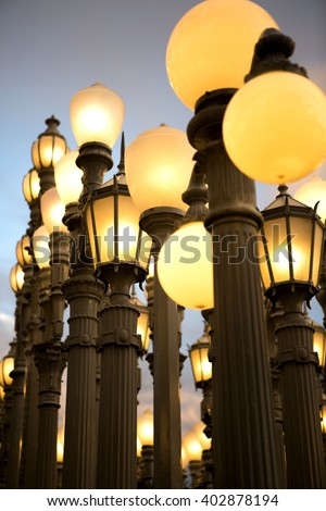 Lamp Posts Lit Up At Dusk In California - stock photo