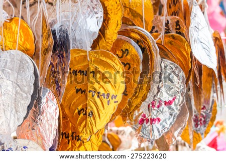 LAMPANG,THAILAND - 15 APRIL, 2015:The Songkran festival is the traditional Thai New Year's Day,they are write paper for pray(Thai language), Lampang, Thailand - stock photo