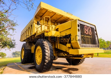 LAMPANG, THAILAND-February 11,2016 : A Retired Lignite coal truck parking at Lignite Education Museum Center in Mae Moh Mine, Lampang on February 11,2016 in Lampang, Thailand. - stock photo