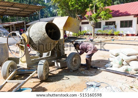 LAMPANG, THAILAND - NOVEMBER 5 : unidentified thai teenagers in working camp preparing the area for pouring concrete to make plaza on November 5, 2016 in Lampang, Thailand.