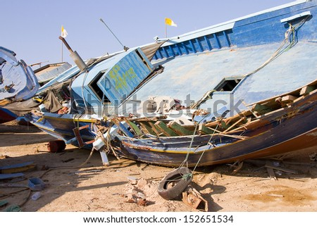 LAMPEDUSA, ITALY - JULY 17: Some broken clandestine boats in Lampedusa harbor, on July 17, 2013 in Lampedusa, Sicily, Italy. Lampedusa island is a primary European entry point for migrants. - stock photo