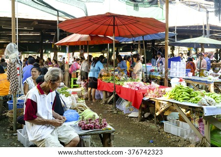 LAMPHUN THAILAND - FEBRUARY 4 : Market villagers walking street, People live in a popular local shopping to cook dinner every day. on Feb. 4, 2016 in Lamphun, Thailand.