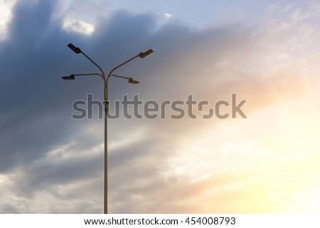 Lamppost against the blue sky with sunlight