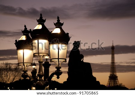 Lamppost and the Eiffel Tower in Paris, France - stock photo